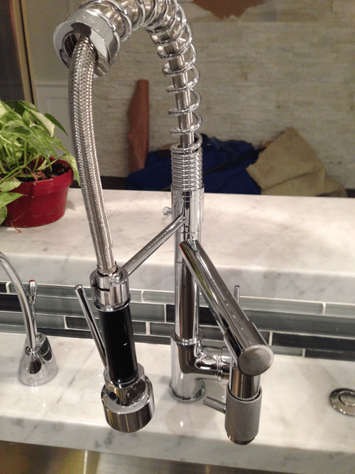 pro-style-kitchen-faucet-in-white-kitchen