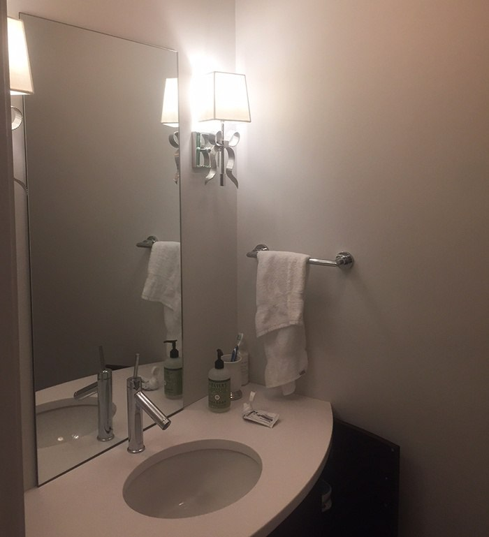Sconces on either side of the mirror -Steve's vanity