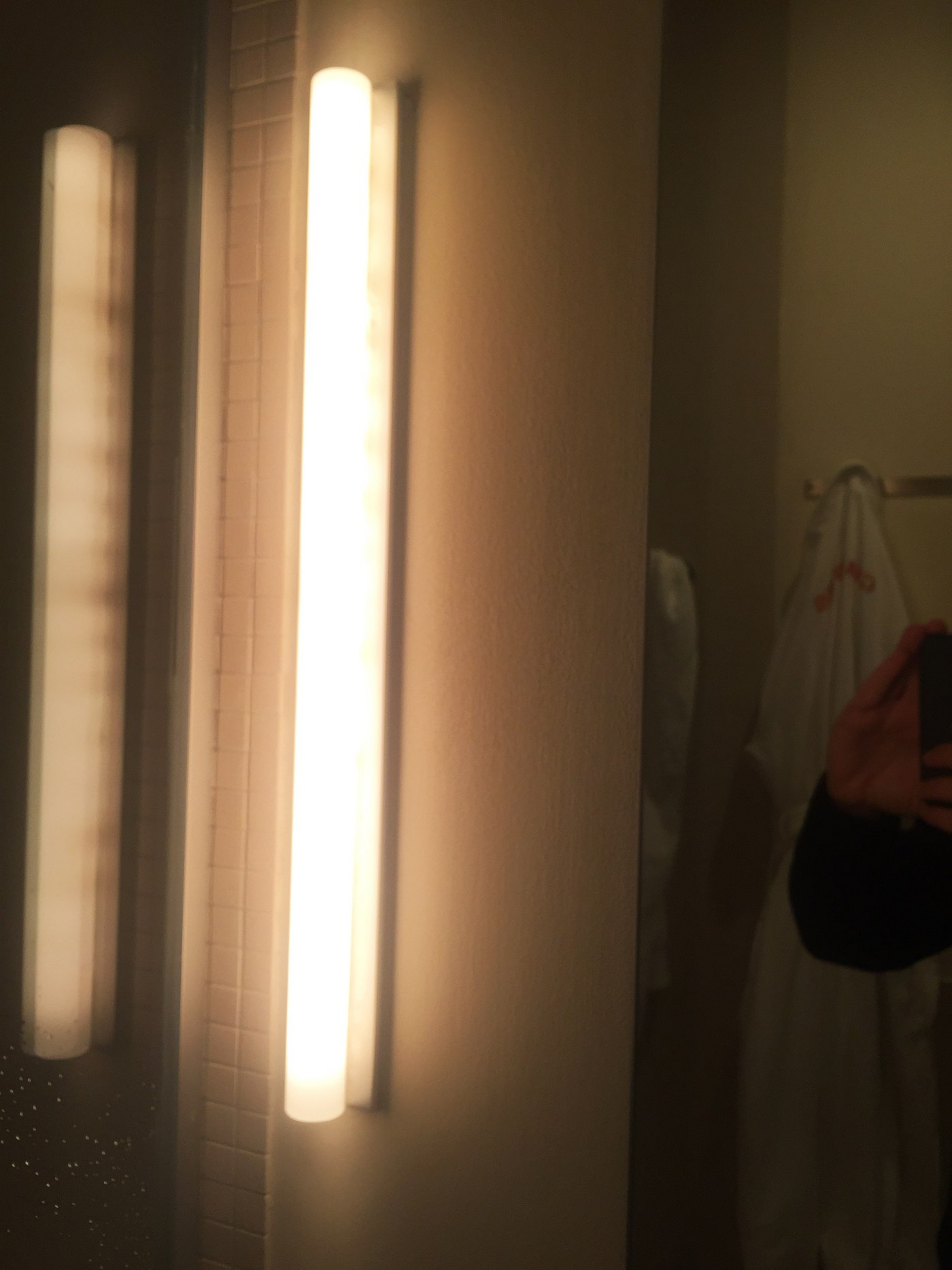 Sconces on either side of the mirror, Chamber Hotel
