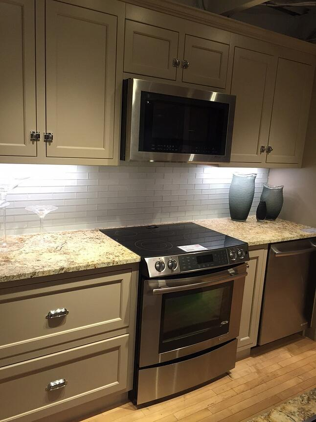 Can you place a gas electric induction cooktop over a wall for High end wall ovens