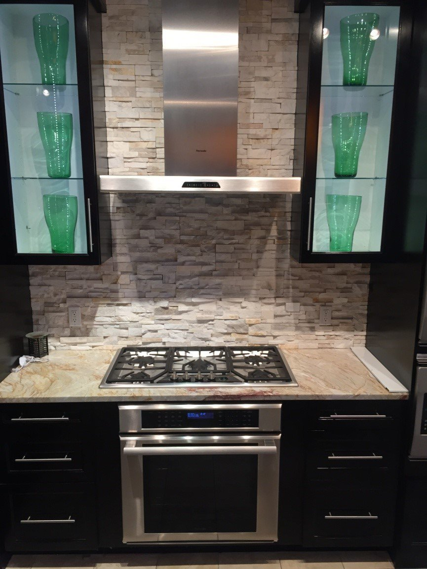Can you place a gas electric induction cooktop over a wall for High end induction range